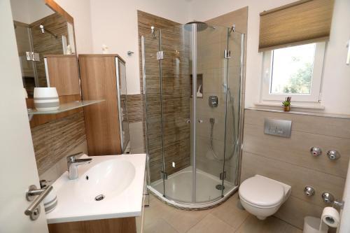 Koupelna v ubytování Apartment Mir
