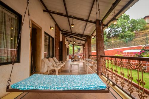 A balcony or terrace at Furniturewala House