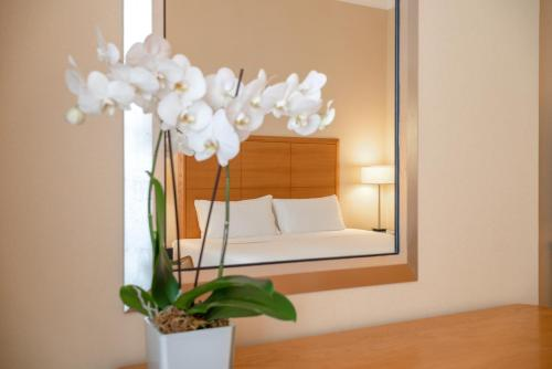 A bed or beds in a room at Hotel Capo d´África – Colosseo