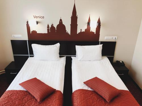 A bed or beds in a room at Elokhovsky Hotel