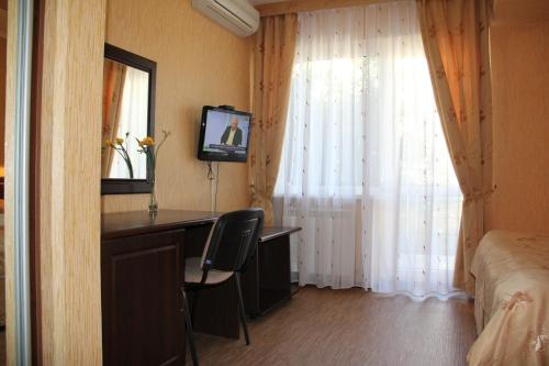 Телевизор и/или развлекательный центр в Отель Аледо