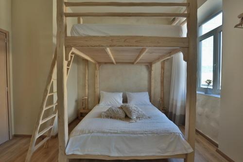 A bunk bed or bunk beds in a room at Ederlezi Boutique Hotel