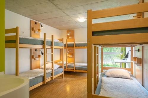 A bunk bed or bunk beds in a room at Backpackers Villa Sonnenhof - Hostel Interlaken