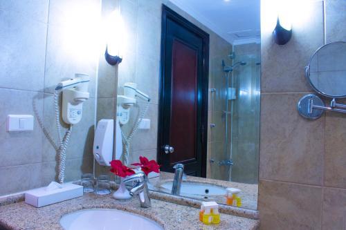 Ванная комната в Parrotel Aqua Park Resort
