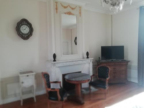 A television and/or entertainment center at Domaine de Bayeux