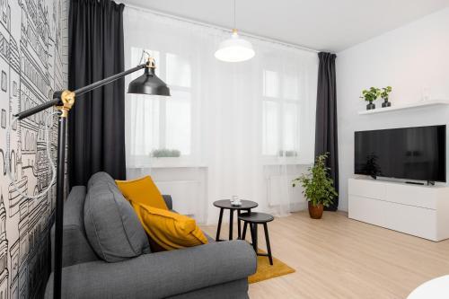 A seating area at Apartament Za Bramką Centrum