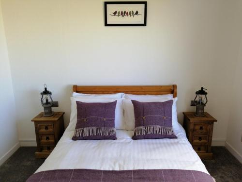 A bed or beds in a room at Haiskeir, Isle of North Uist