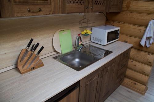 Кухня или мини-кухня в Кипревская база отдыха