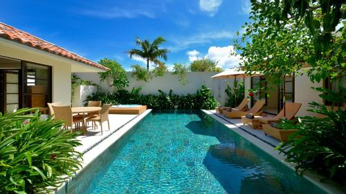 The swimming pool at or near The Uza Terrace Beach Club Villas