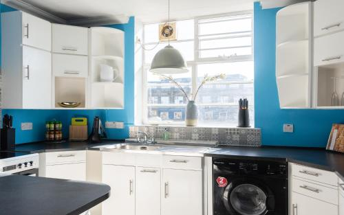 A kitchen or kitchenette at The West End Penthouse - 4BDR with Views