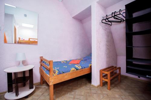 Кровать или кровати в номере Гостевой дом АГАТ