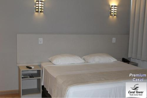 A bed or beds in a room at Coral Trade - Hospitais Puc RS e Clínicas - Pet Friendly