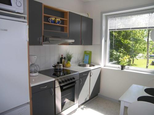A kitchen or kitchenette at Vestergade 7 Holiday Apartments