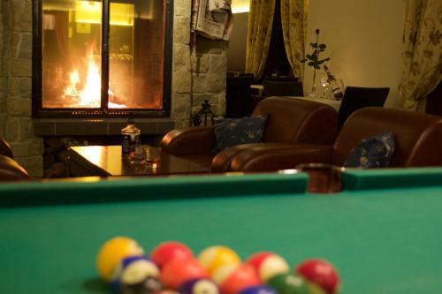A billiards table at Hotel Patria Zakopane