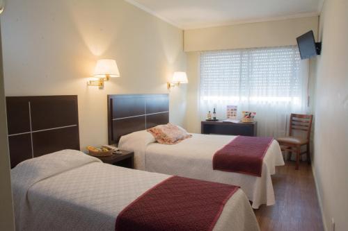 Ein Bett oder Betten in einem Zimmer der Unterkunft Hotel Europa