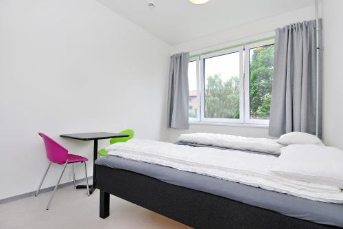 A bed or beds in a room at Anker Apartment