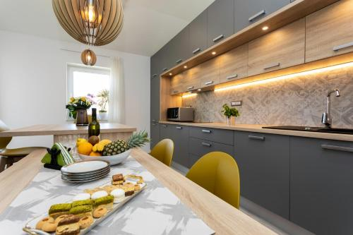 A kitchen or kitchenette at Brand New Apartment in Klimno