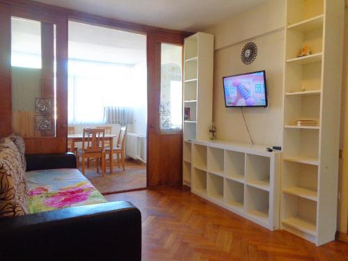 Телевизор и/или развлекательный центр в Apartment on Vorovskogo 19