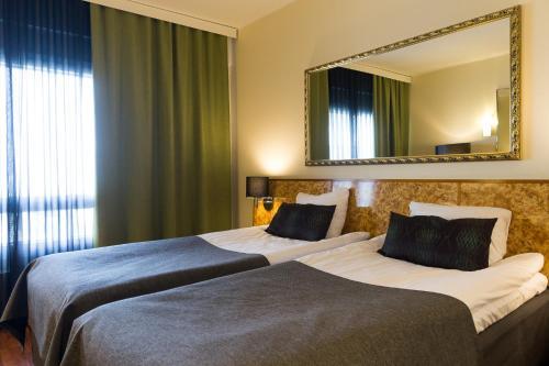 Vuode tai vuoteita majoituspaikassa Hotel Verso