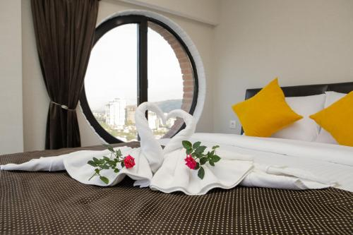 A bed or beds in a room at 11Floor Boutique Hotel
