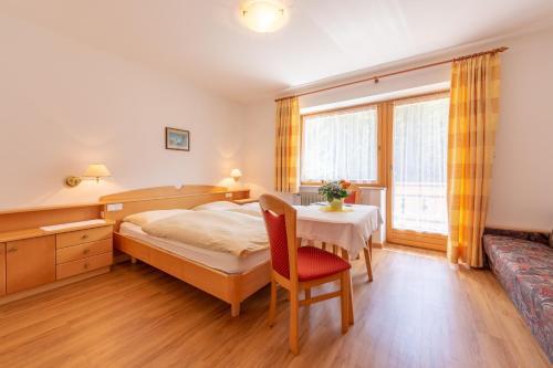 Un ou plusieurs lits dans un hébergement de l'établissement Residence Trenker Luis