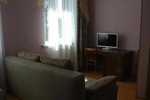 Гостиная зона в Отель Родник Чагода