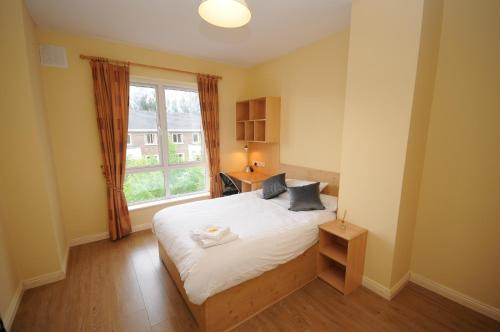 A bed or beds in a room at Gort Na Coiribe Holiday Village
