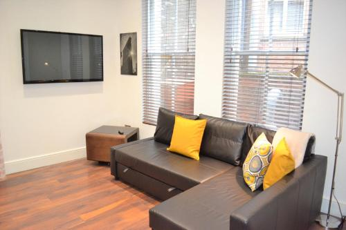 A seating area at OnPoint Apartments - PERFECT 5-Star Deluxe Apartment City Centre VIP