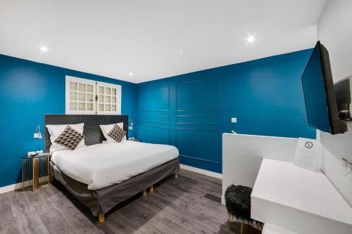 Cama o camas de una habitación en The Element Hôtel