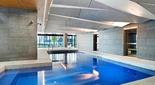 The swimming pool at or near A Cozy CBD Suite Near Southern Cross + Pool & Gym