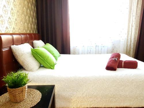 Кровать или кровати в номере Apartment in Cheboksary city center