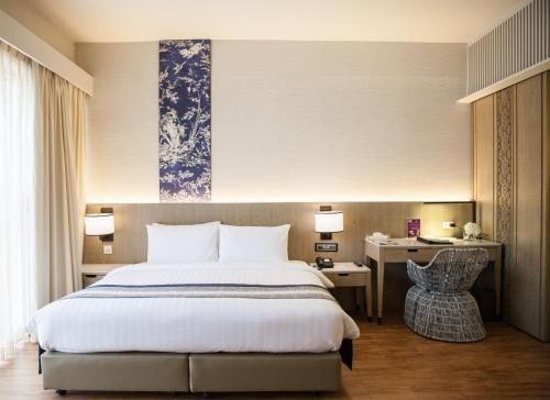 A bed or beds in a room at The Royal Paradise Hotel & Spa