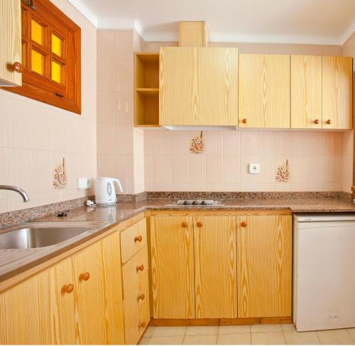 A kitchen or kitchenette at Apartamentos Sol y Mar