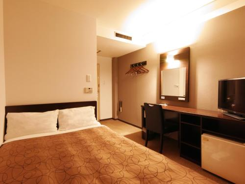 A bed or beds in a room at Kumamoto Green Hotel
