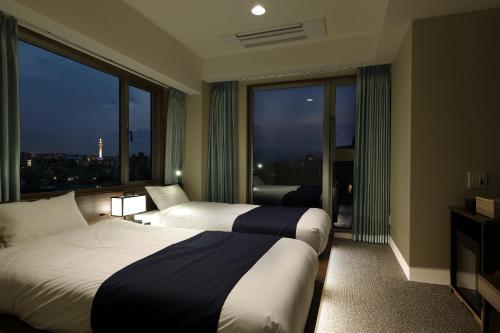 Ein Bett oder Betten in einem Zimmer der Unterkunft SUMITEI KIYOMIZU GOJO