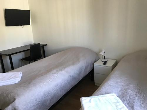 A bed or beds in a room at Gästhem Neptun