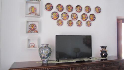 A television and/or entertainment center at Casa vacanze Margherita