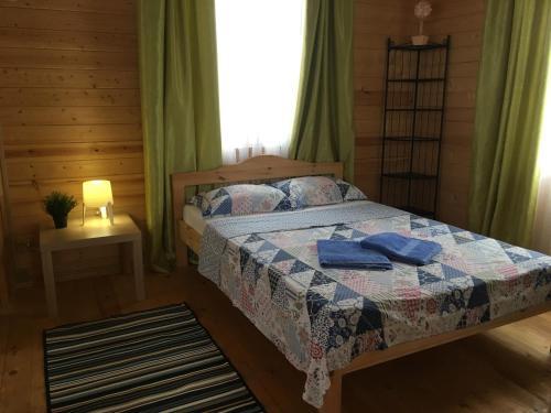 Кровать или кровати в номере Bungalo u Limana