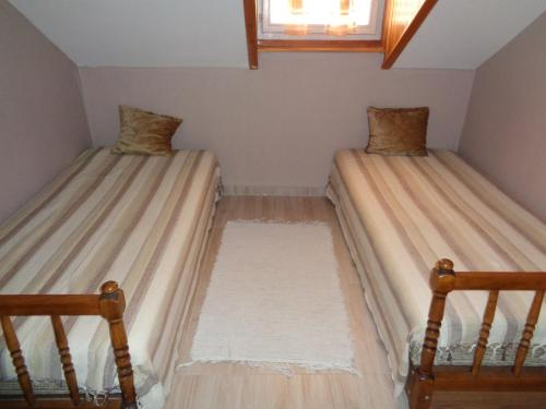 A bed or beds in a room at Irénke Vendégház