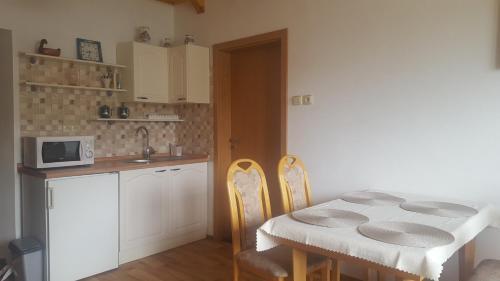 Kuchyň nebo kuchyňský kout v ubytování Apartman Kuća