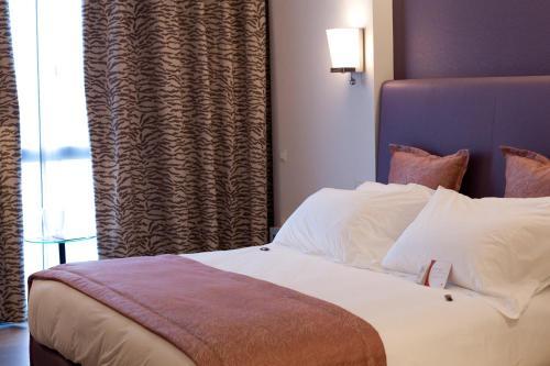 Letto o letti in una camera di Crowne Plaza Verona Fiera