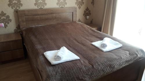 A bed or beds in a room at Ananiko