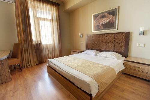 A bed or beds in a room at Kantar Hostel