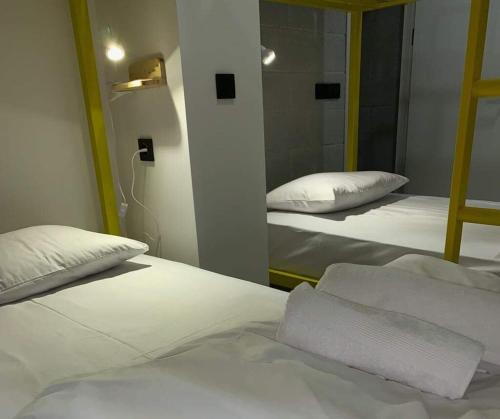 A bed or beds in a room at Duck Hostel