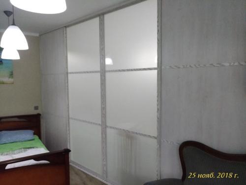 Кровать или кровати в номере Apartment Kaliningradsky prospekt 71A