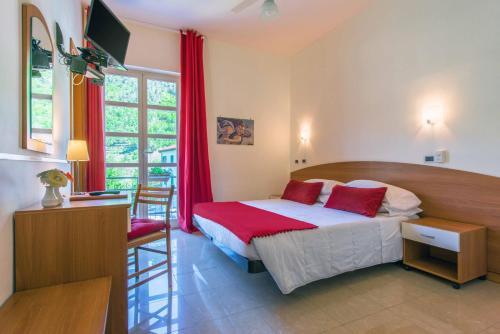 Letto o letti in una camera di Hotel Ca' De Berna