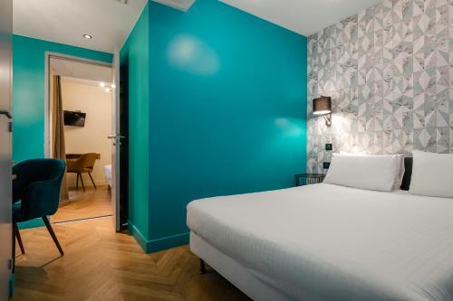 Cama o camas de una habitación en Hotel Elysée Etoile