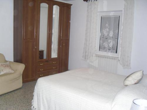 A bed or beds in a room at Appartamenti Il Leone
