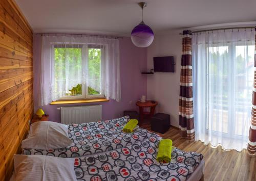 A bed or beds in a room at B&B Villa Varmia