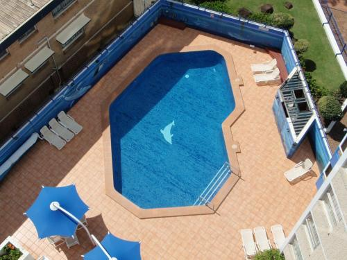 A view of the pool at Grosvenor Beachfront Apartments or nearby